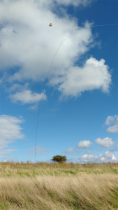 An 85ft wire antenna suspended from a box kite (line enhanced for visibility in the image). Glorious!